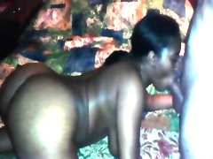 Sexy ebony hottie deepthroating a big..