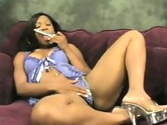 Ebony woman vibrates her pussy with a..
