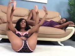 Lesbian ebony cuties having oral sex..