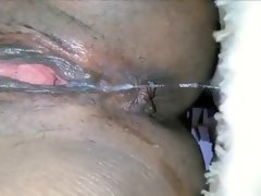 Ebony babe masturbates and squirts
