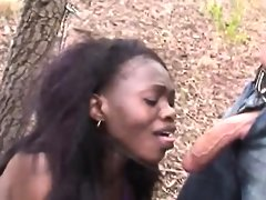 Slutty african teen sucks cock while..
